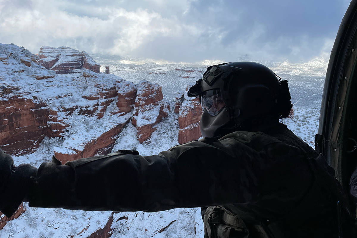 This photo provided by the Arizona National Guard shows a UH-60 Black Hawk crew with the Arizon ...
