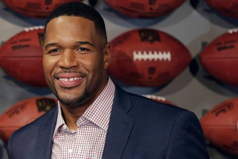 In this Thursday, Nov. 30, 2017 file photo, Former New York Giant Michael Strahan poses for a p ...