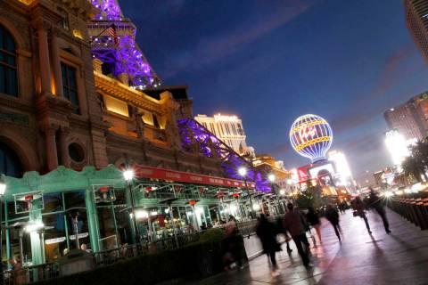 People walk along Las Vegas Boulevard on the Las Vegas Strip, Tuesday, Nov. 17, 2020. (Chitose ...
