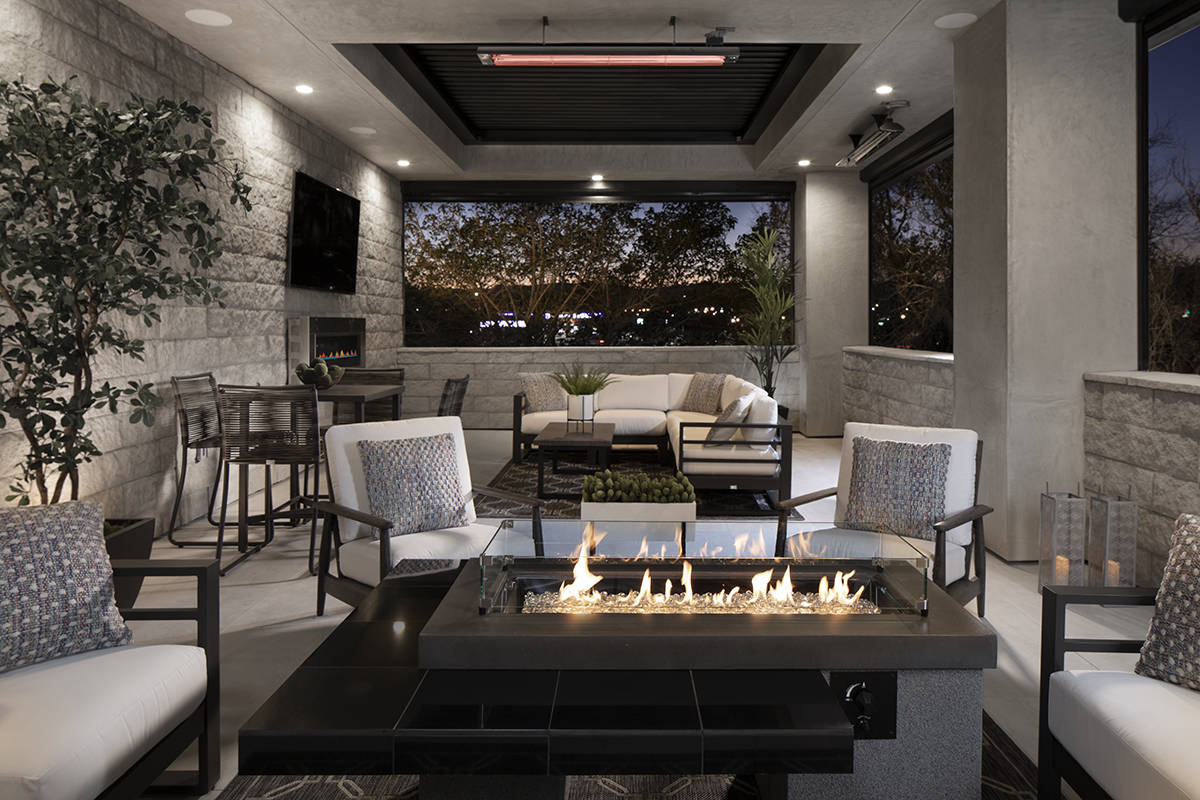 The pocket doors open to a backyard has a heated pool, waterfall and outdoor heaters. It home h ...