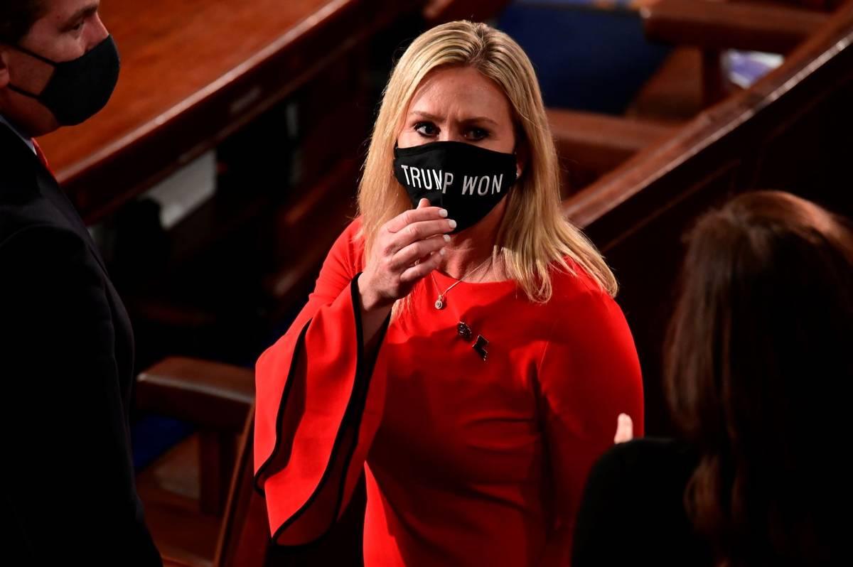 "Rep. Marjorie Taylor Greene, R-Ga., wears a ""Trump Won"" face mask as she arrives on the floor o ..."