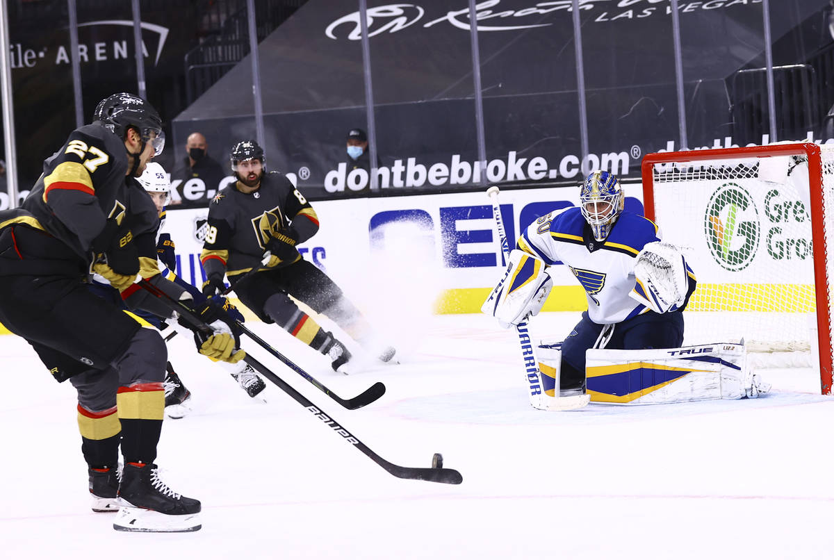 Golden Knights defenseman Shea Theodore (27) looks to shoot against St. Louis Blues goaltender ...