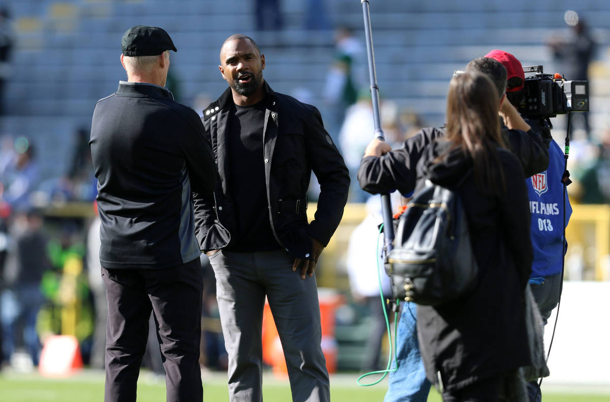 Oakland Raiders general manager Mike Mayock, left, speaks with former Raiders and Packers corne ...