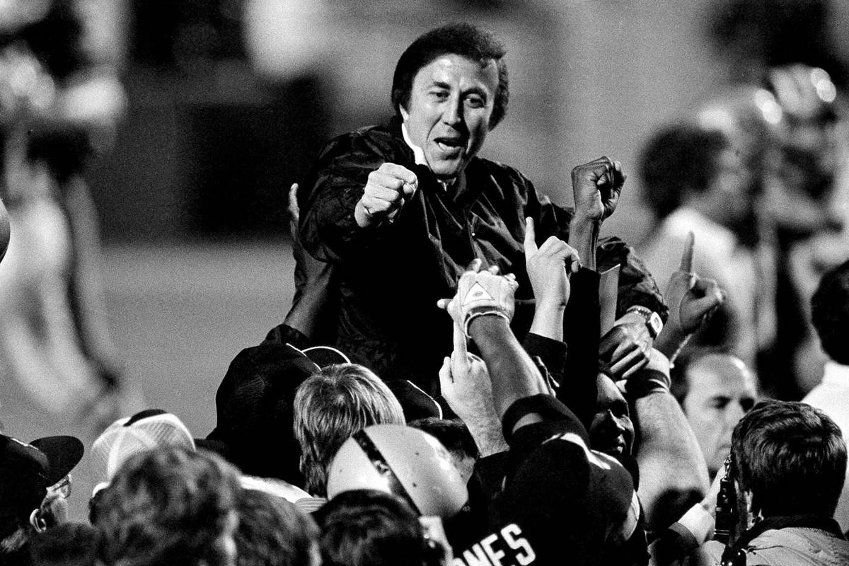 In this Jan. 23, 1984, file photo, coach Tom Flores gestures to members of the Los Angeles Raid ...