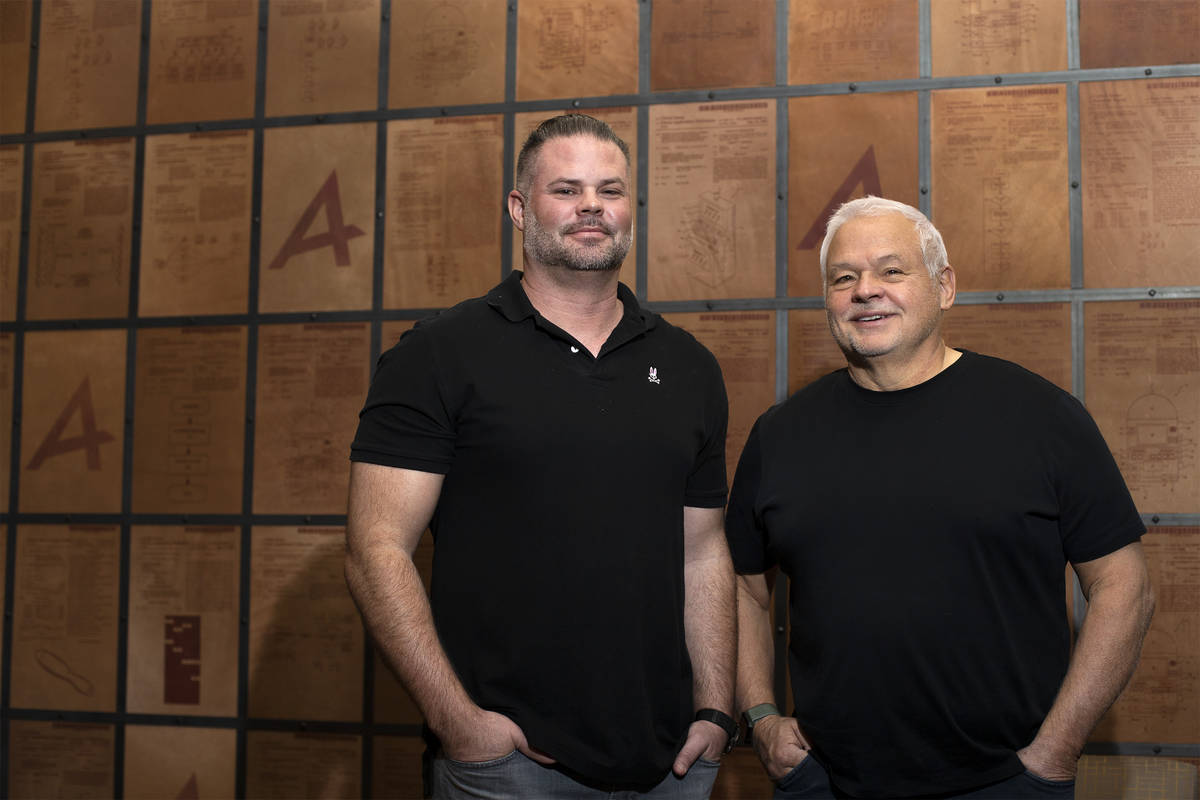 Noah Acres, left, and John Acres, makers of a new player tracking system, pose for a photo at A ...