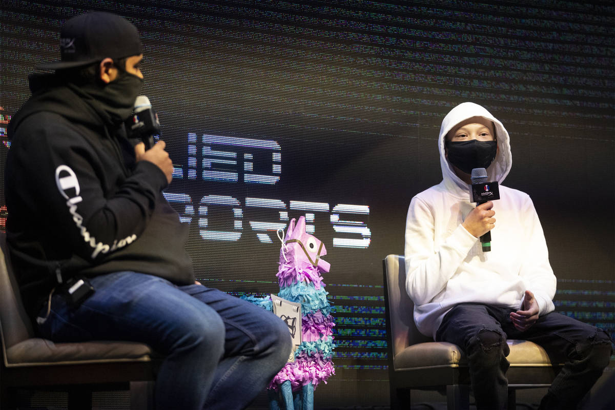 Enzo Durand, 13, right, is inteviewed by host Noor Jehangir, during the Fortnite tournament &qu ...