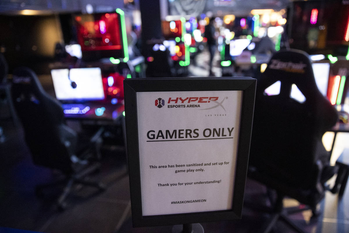 """A sign informing people of a player only zone during the Fortnite tournament """"Friday Night ..."""