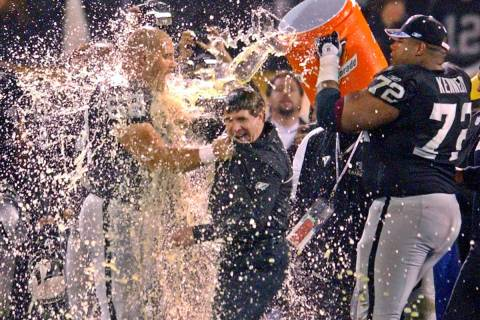 Oakland Raiders coach Bill Callahan gets doused with gatorade by Adam Treu, left, and Lincoln K ...