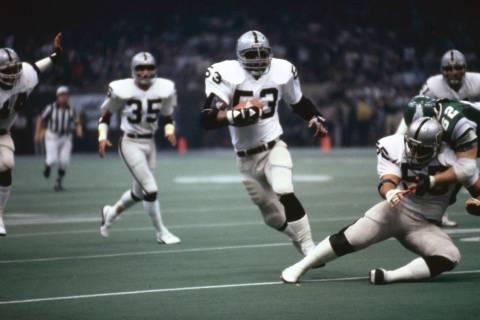 Oakland Raiders linebacker Rod Martin (53) intercepts a pass and runs upfield during Super Bowl ...