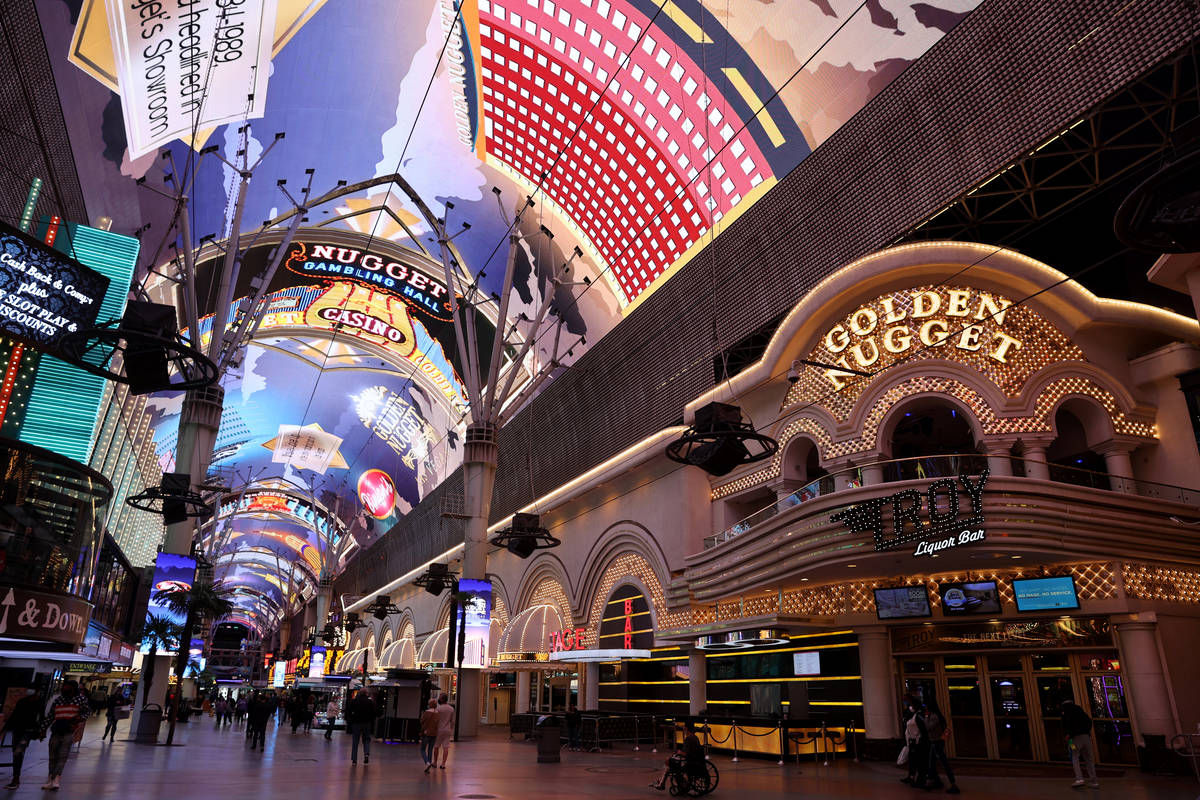 Golden Nugget historical images are shown on the canopy at the Fremont Street Experience in dow ...