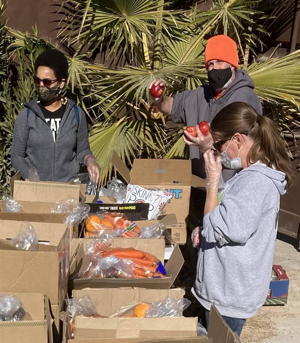 LasVegan Food Bank volunteers assemble grocery boxes on Jan. 23 at the nonprofit RIR Animal San ...