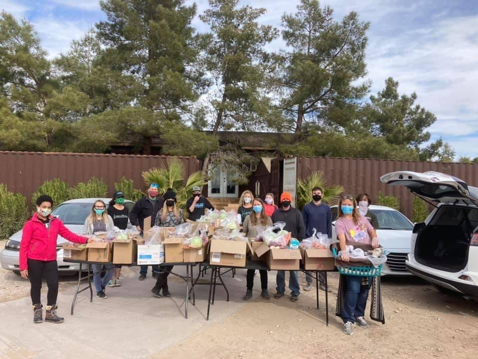 LasVegan Food Bank volunteers with the food boxes they assembled to distribute to vegans in nee ...