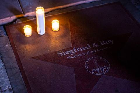 Candles are lit in memory of Siegfried Fischbacher, half of the legendary illusion team Siegfri ...