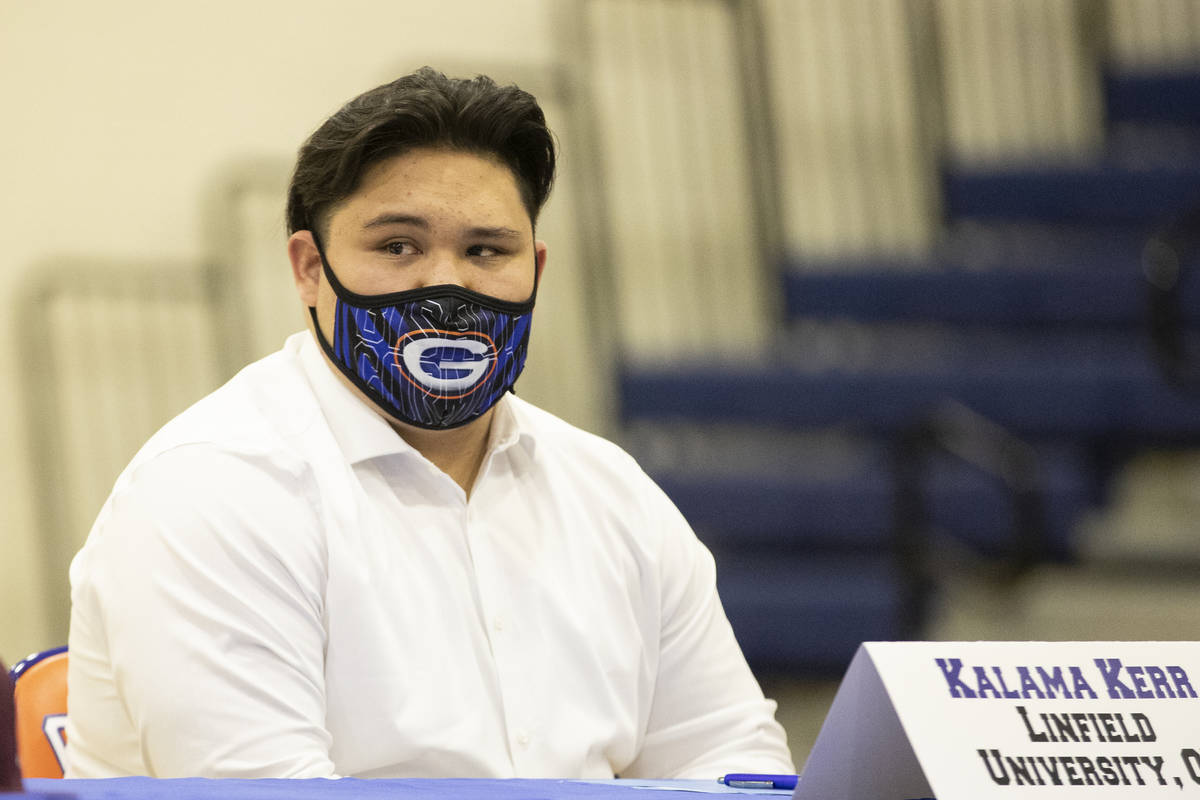 Football player Kalama Kerr, a Linfield University commit, participates during a Signing day c ...