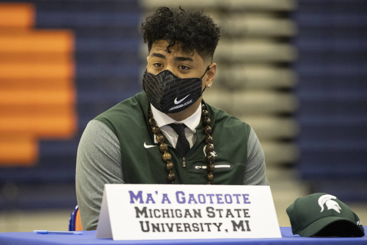 Football player Ma'a Gaoteote, a Michigan State commit, participates during a Signing day cerem ...