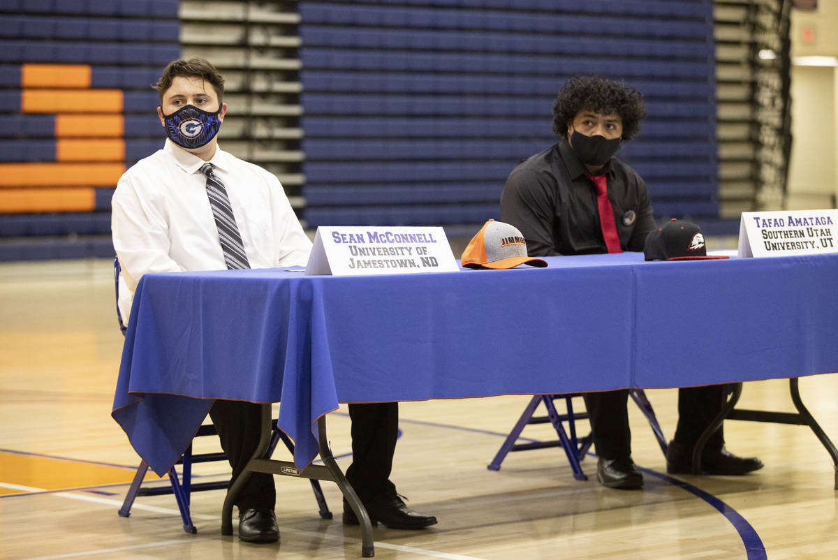 Football players Sean McConnell, left, a Jamestown University commit, and Tafao Amataga, a Sout ...