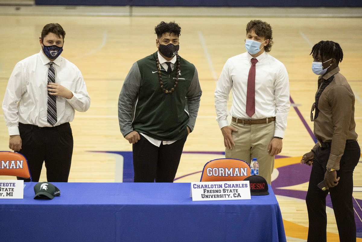 Football players from left, Sean McConnell, a Jamestown University commit, Ma'a Gaoteote, a Mic ...