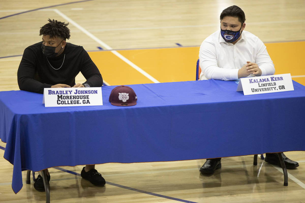 Football players Bradley Johnson, left, a Morehouse College commit, and Kalama Kerr, a Linfield ...