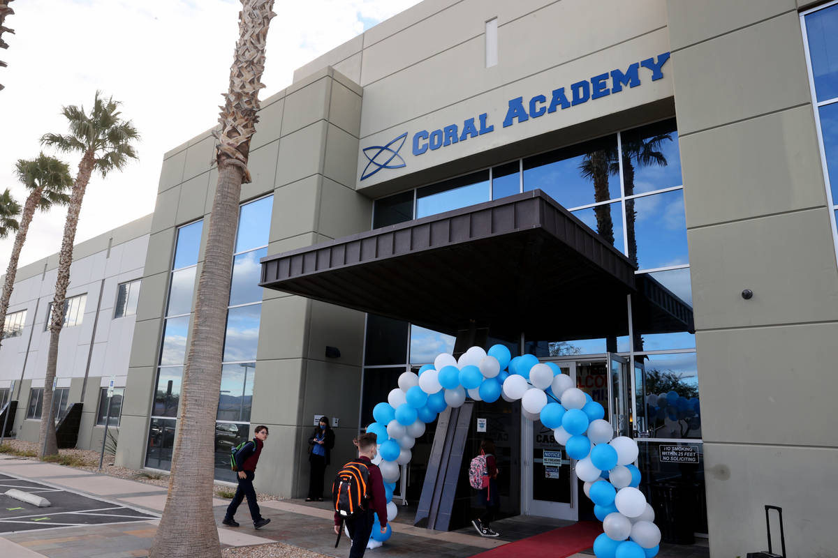 Students walk the red carpet at the start of school at Coral Academy of Science Centennial Hill ...