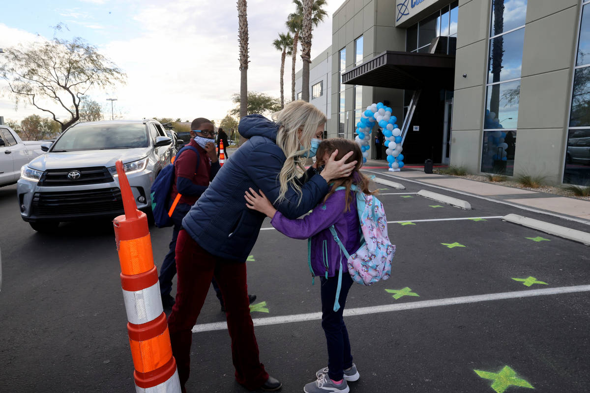 Kim Salerno kisses her daughter Tegan, 7, goodbye at the start of school at Coral Academy of Sc ...