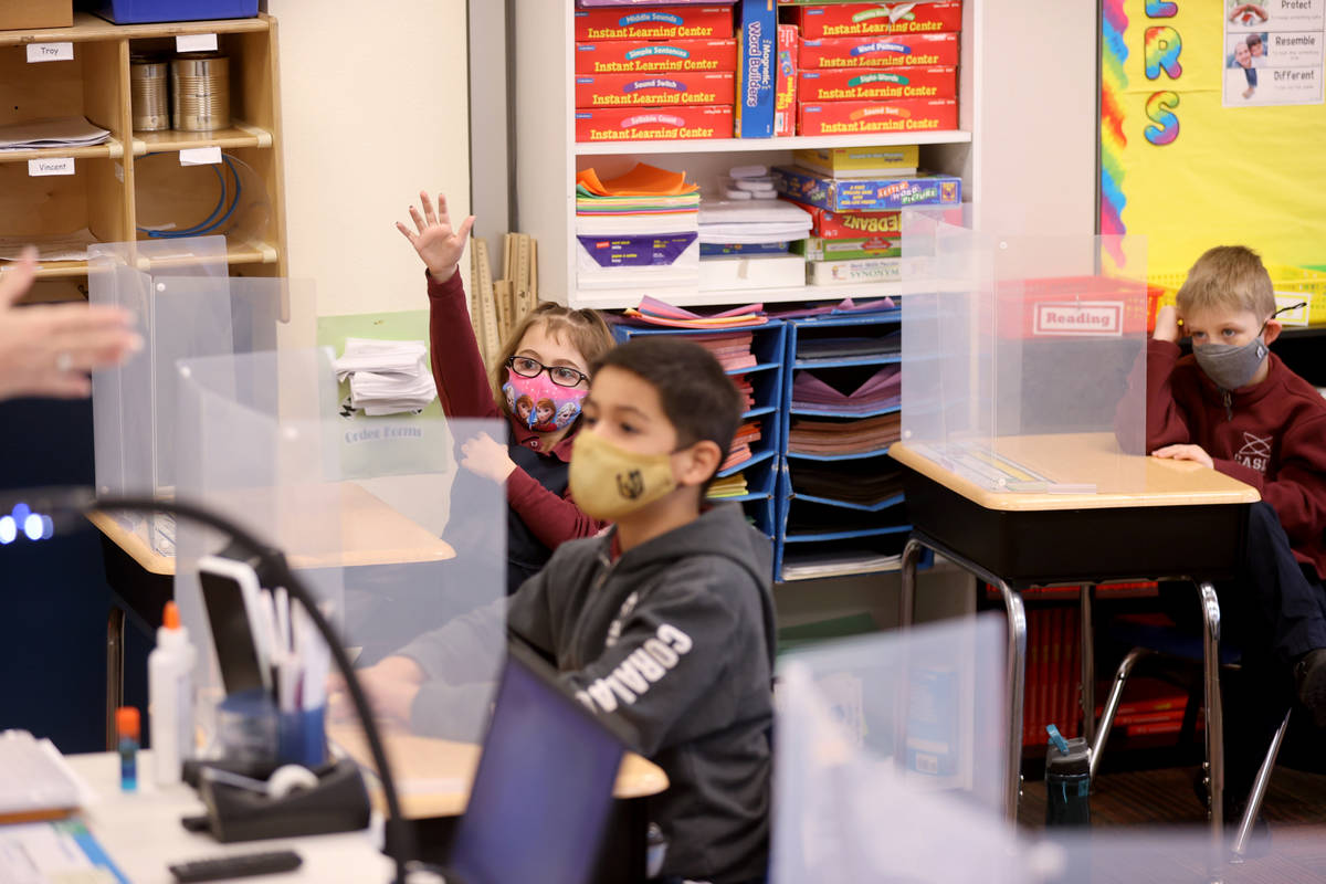 First grade students, from left, Cora Reardon, 6, Vincent Morales 6, Logan Breen, 7, attend in ...