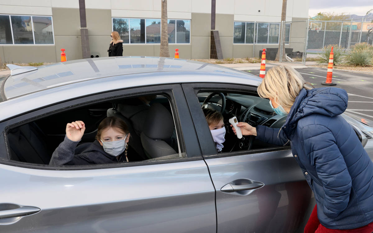 Kim Salerno takes the temperture of Dakota Marx, 7, left, and Connor Nielsen, 8, at the start o ...