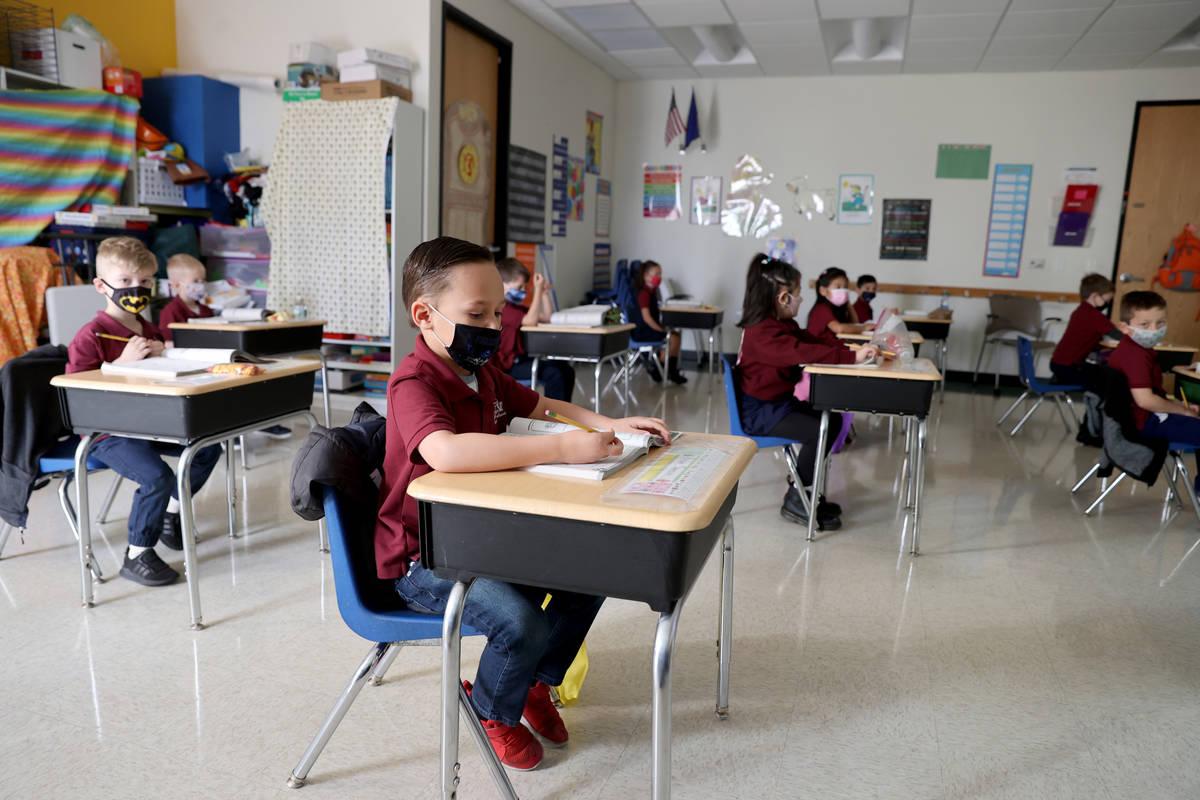 Nolan Sumsion, 6, center, in Tammy Schuster's kindergarten class during school at Coral Academy ...