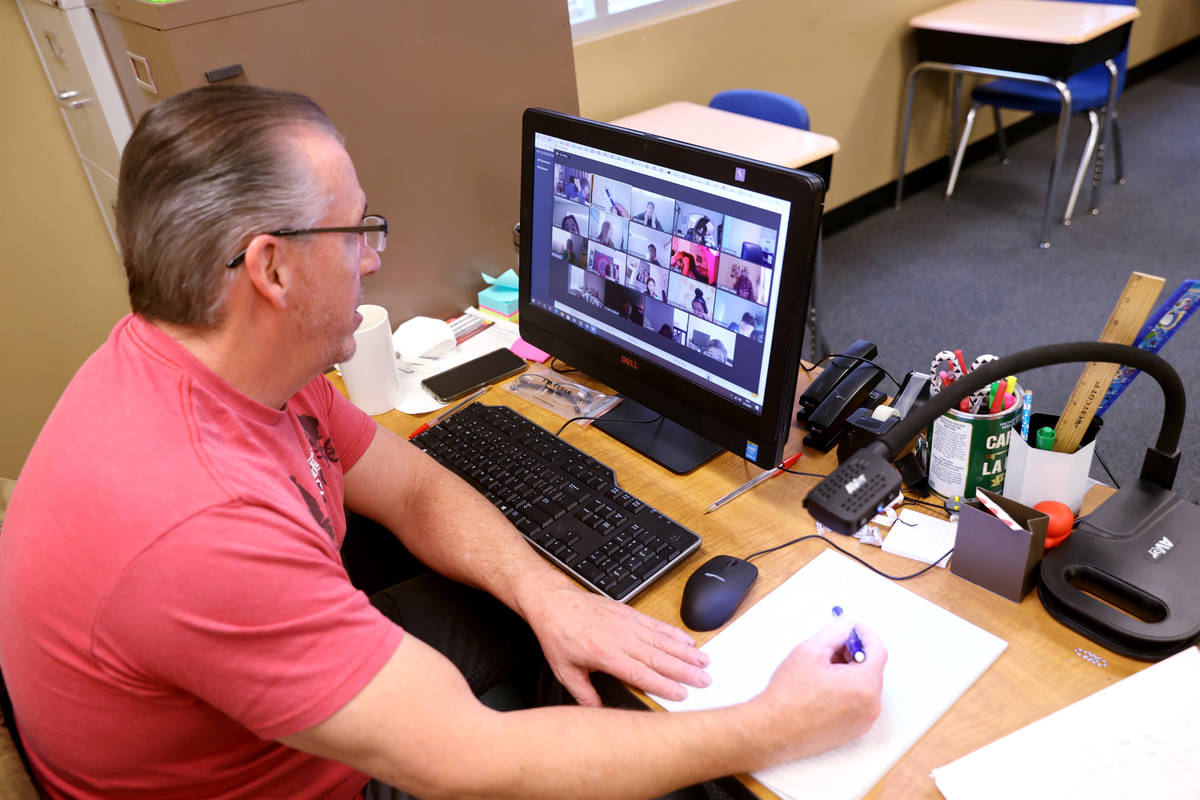 Roger Dunnavant teaches students remotely at during school Coral Academy of Science Centennial ...