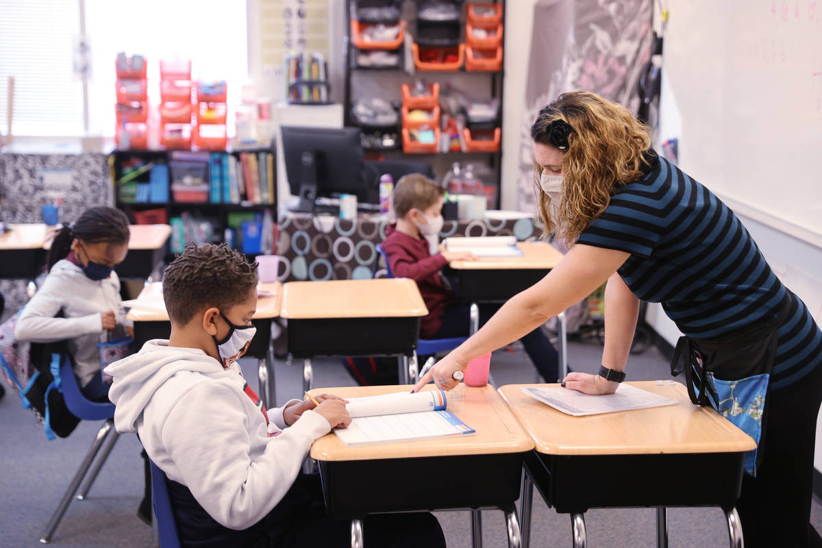 Teacher Michalle Santo Pietro works with Darrell Cosey, 10, during school at Coral Academy of S ...