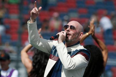 Pitbull performs prior to a NASCAR Cup Series auto race at Phoenix Raceway in Avondale Ariz., i ...