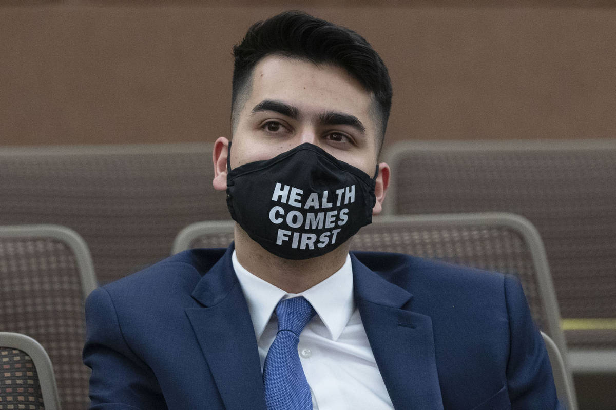 Fabian Donate listens as Clark County Commissioners appointed him to the Nevada State Senate Di ...