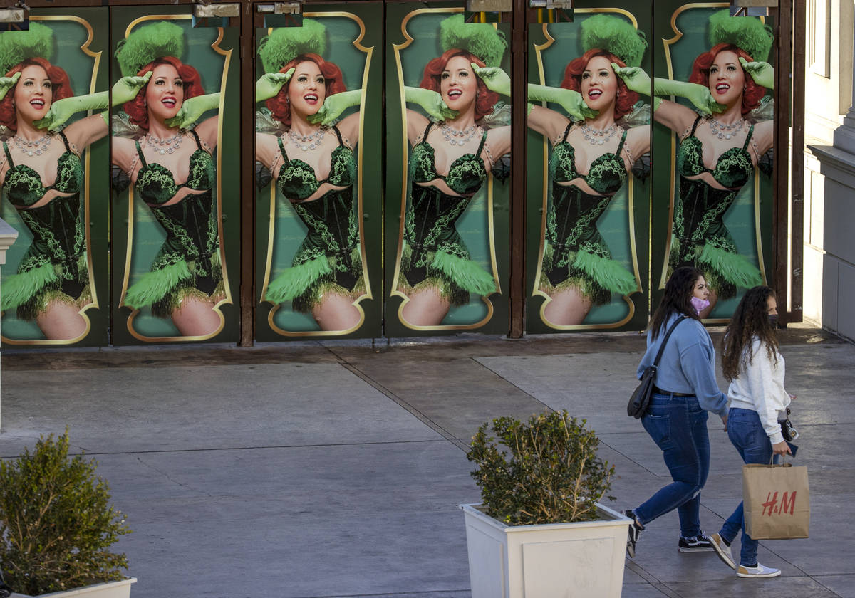 Several shoppers move past the Absinthe main doors nears Caesars Palace along the Las Vegas Str ...