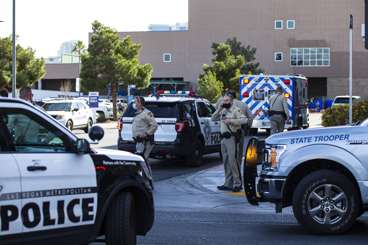 Las Vegas police and Nevada Highway Patrol troopers gather outside of University Medical Center ...