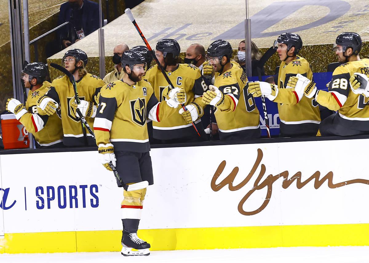 Golden Knights defenseman Alex Pietrangelo (7) celebrates his goal with teammates during the fi ...