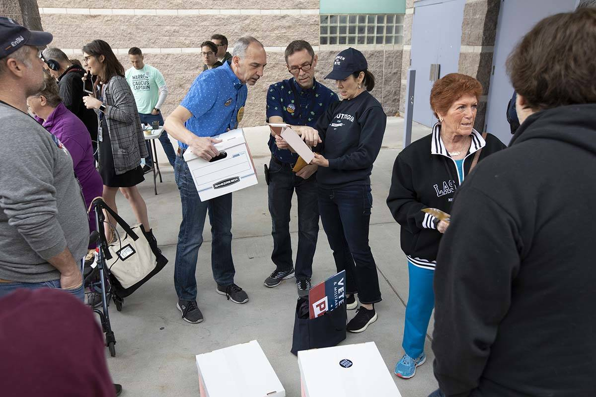 Pete Buttigieg supporters converse before the Nevada caucus begins at Palo Verde High School on ...