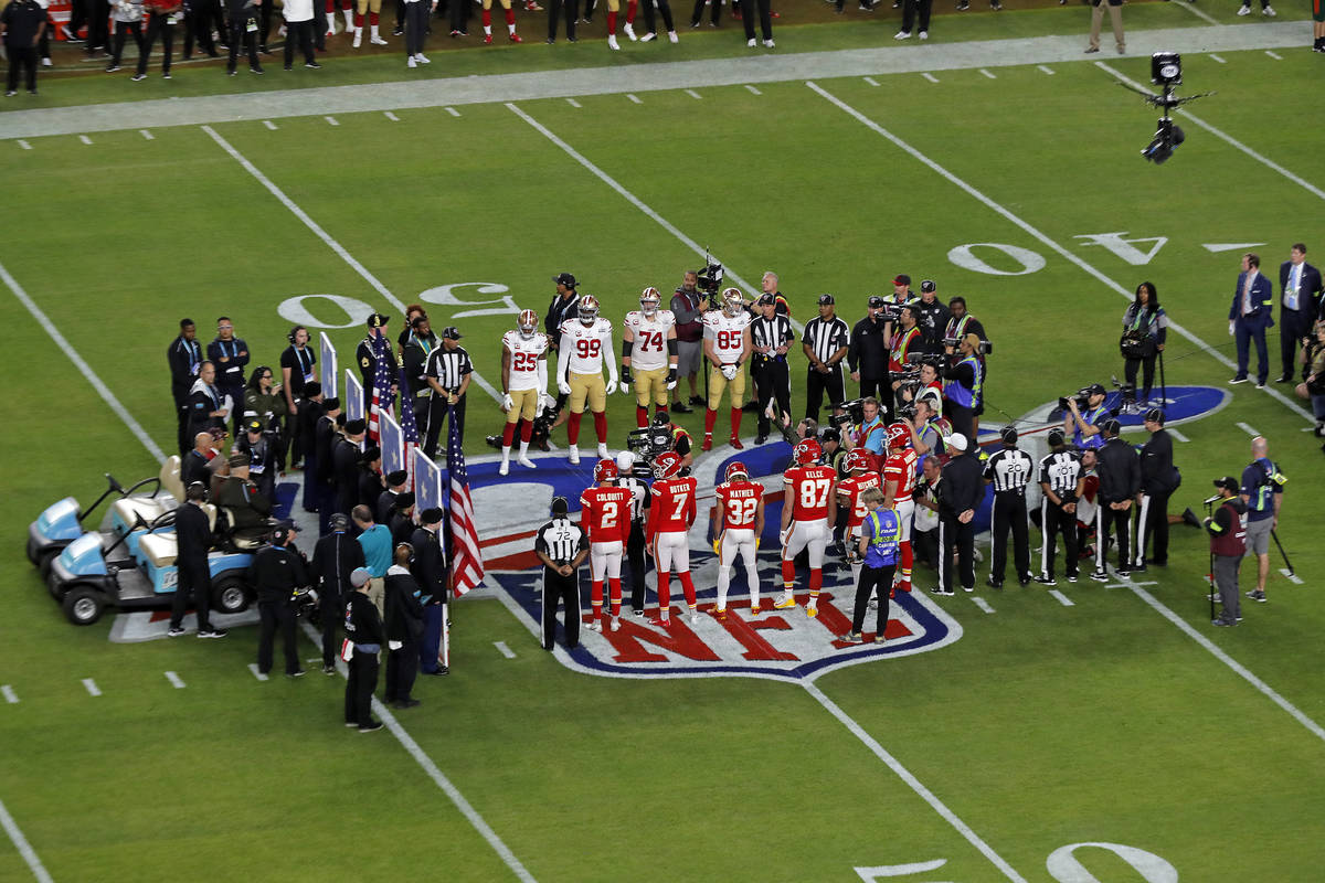The coin toss between the San Francisco 49ers and the Kansas City Chiefs prior to the NFL Super ...