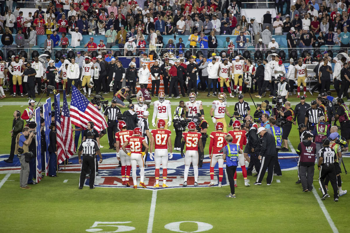 The San Francisco 49ers and Kansas City Chiefs' captains participate in the coin toss before Su ...