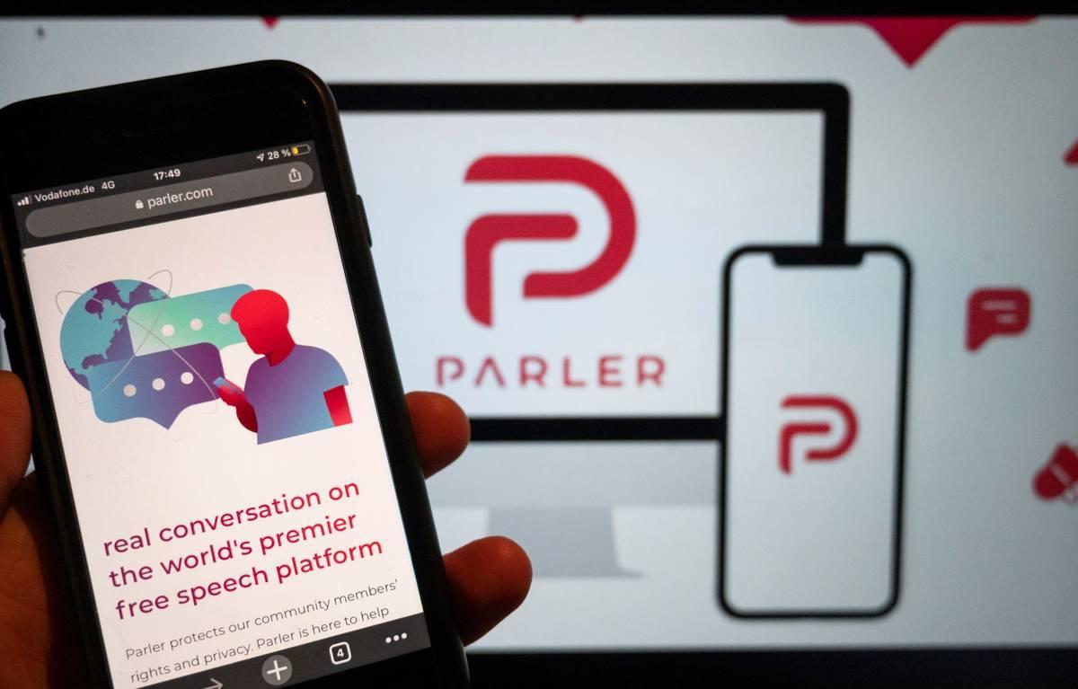 The website of the social media platform Parler is displayed in Berlin. (Christophe Gateau/dpa ...