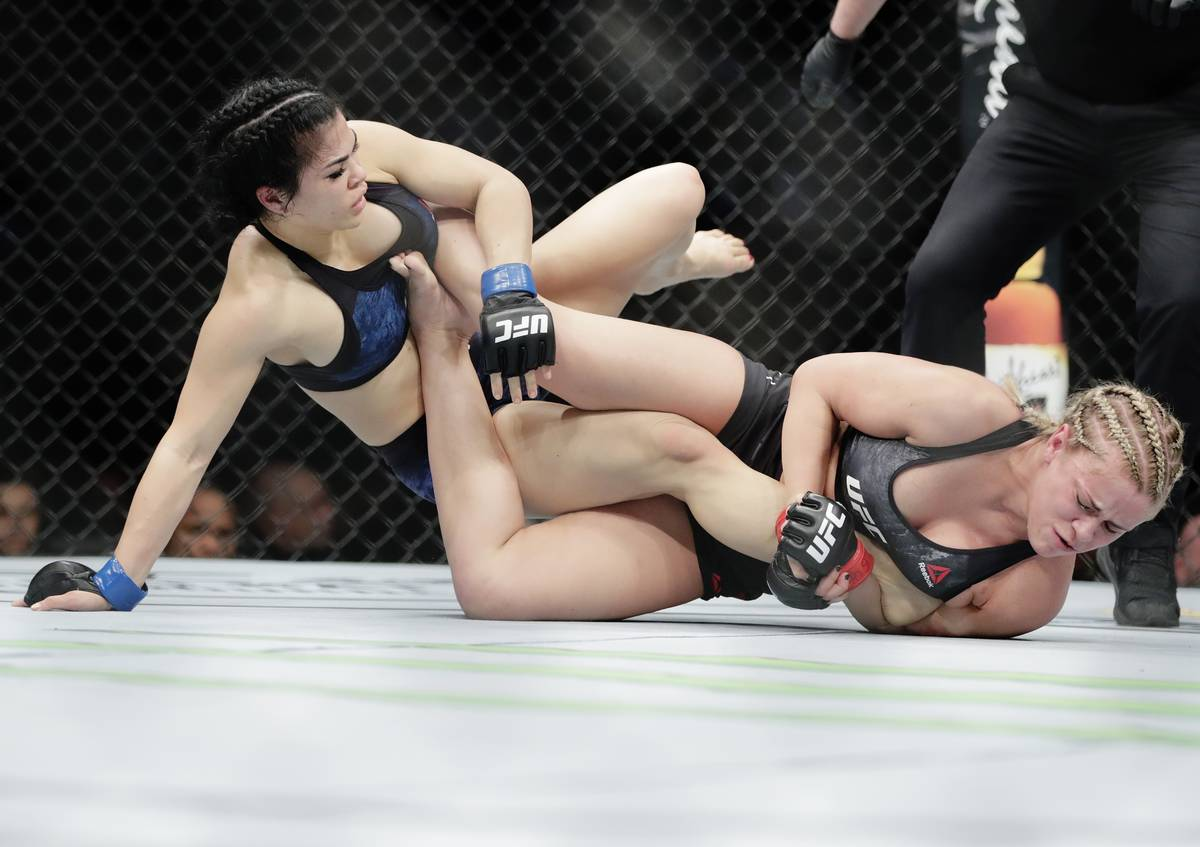 Rachael Ostovich, left, grapples with Paige Vanzant during the first round of a women's flyweig ...