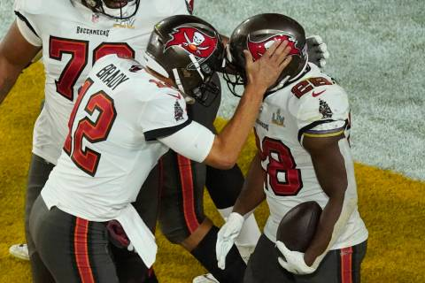 Tampa Bay Buccaneers' Leonard Fournette (28) celebrates his touchdown run with quarterback Tom ...