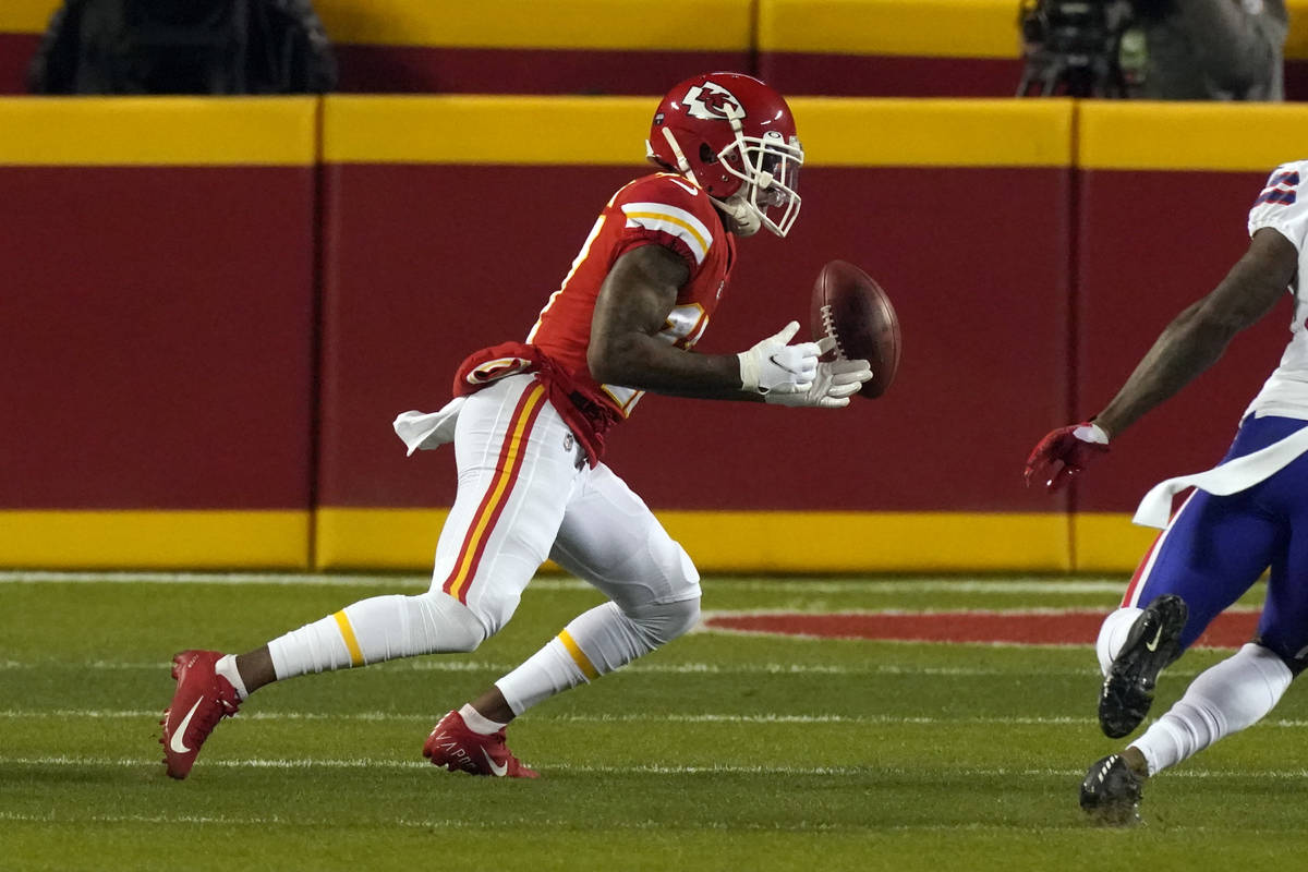 Kansas City Chiefs wide receiver Mecole Hardman fumbles a punt during the first half of the AFC ...