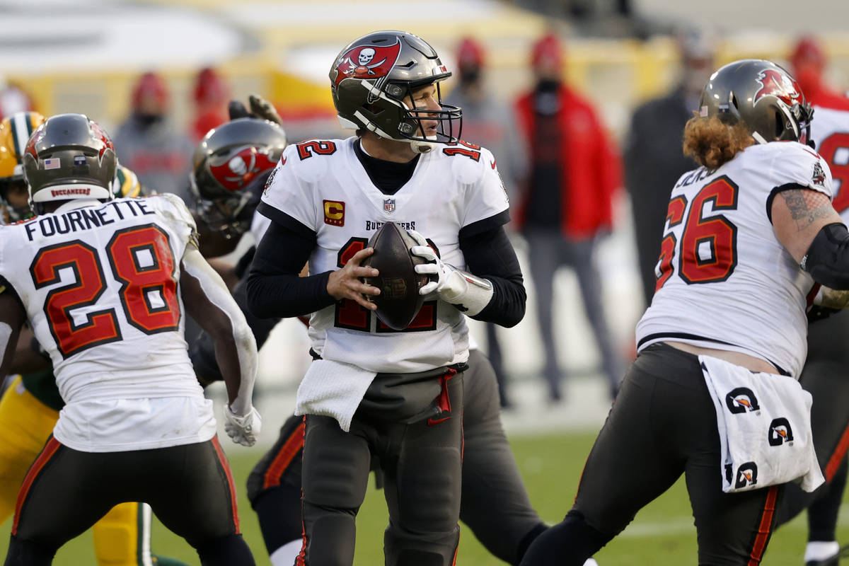 Tampa Bay Buccaneers quarterback Tom Brady (12) looks to pass against the Green Bay Packers dur ...