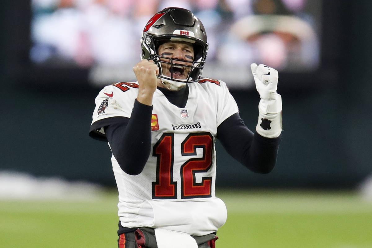 FILE - In this Sunday, Jan. 24, 2021, file photo, Tampa Bay Buccaneers quarterback Tom Brady re ...