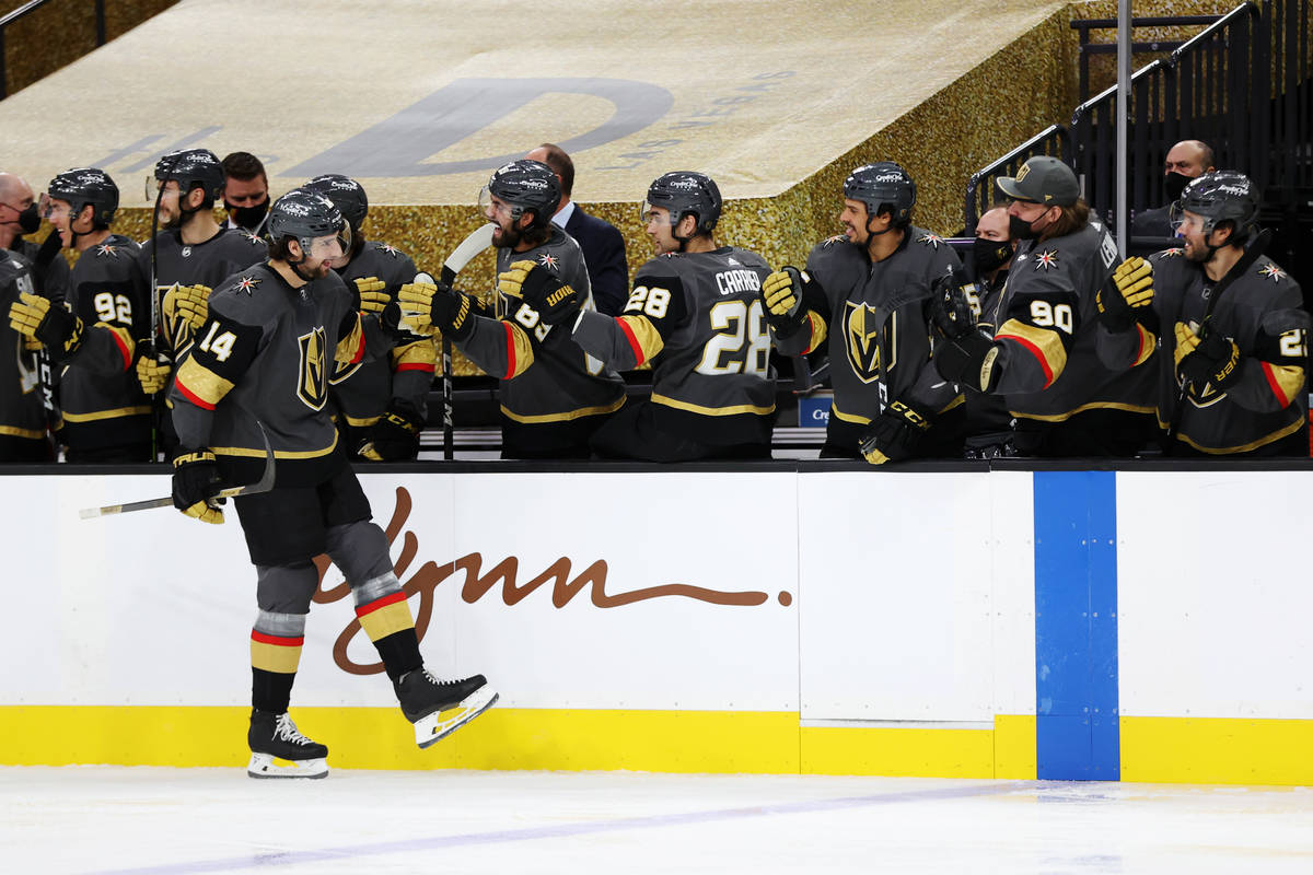 Vegas Golden Knights defenseman Nicolas Hague (14) celebrates a goal with his team during the f ...