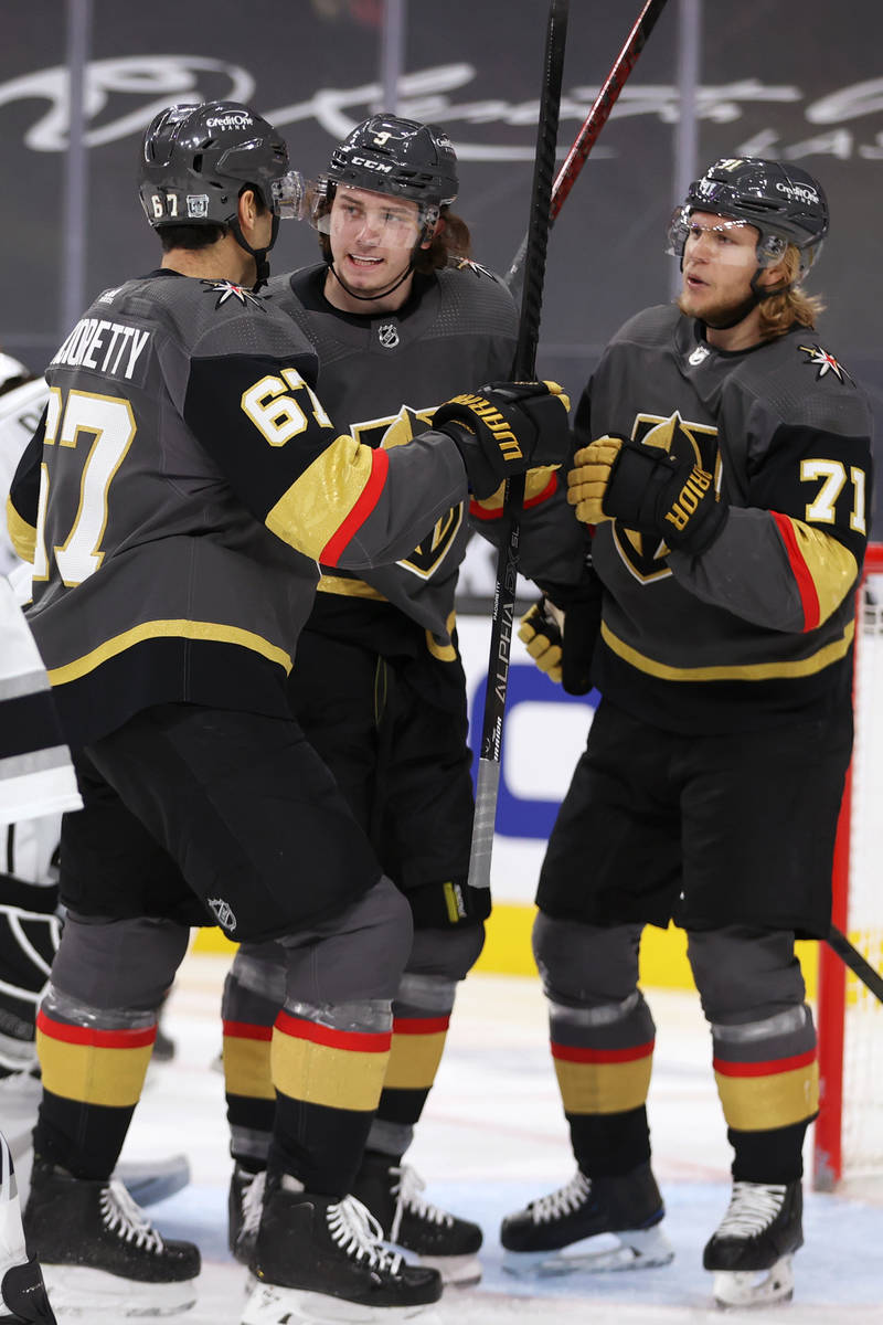 Vegas Golden Knights Cody Glass (9) celebrates his score with left wing Max Pacioretty (67) and ...