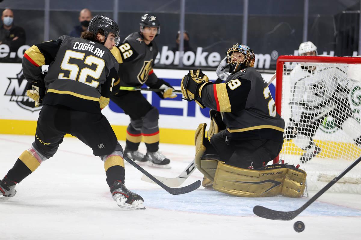 Vegas Golden Knights goaltender Marc-Andre Fleury (29) and defenseman Dylan Coghlan (52) defend ...