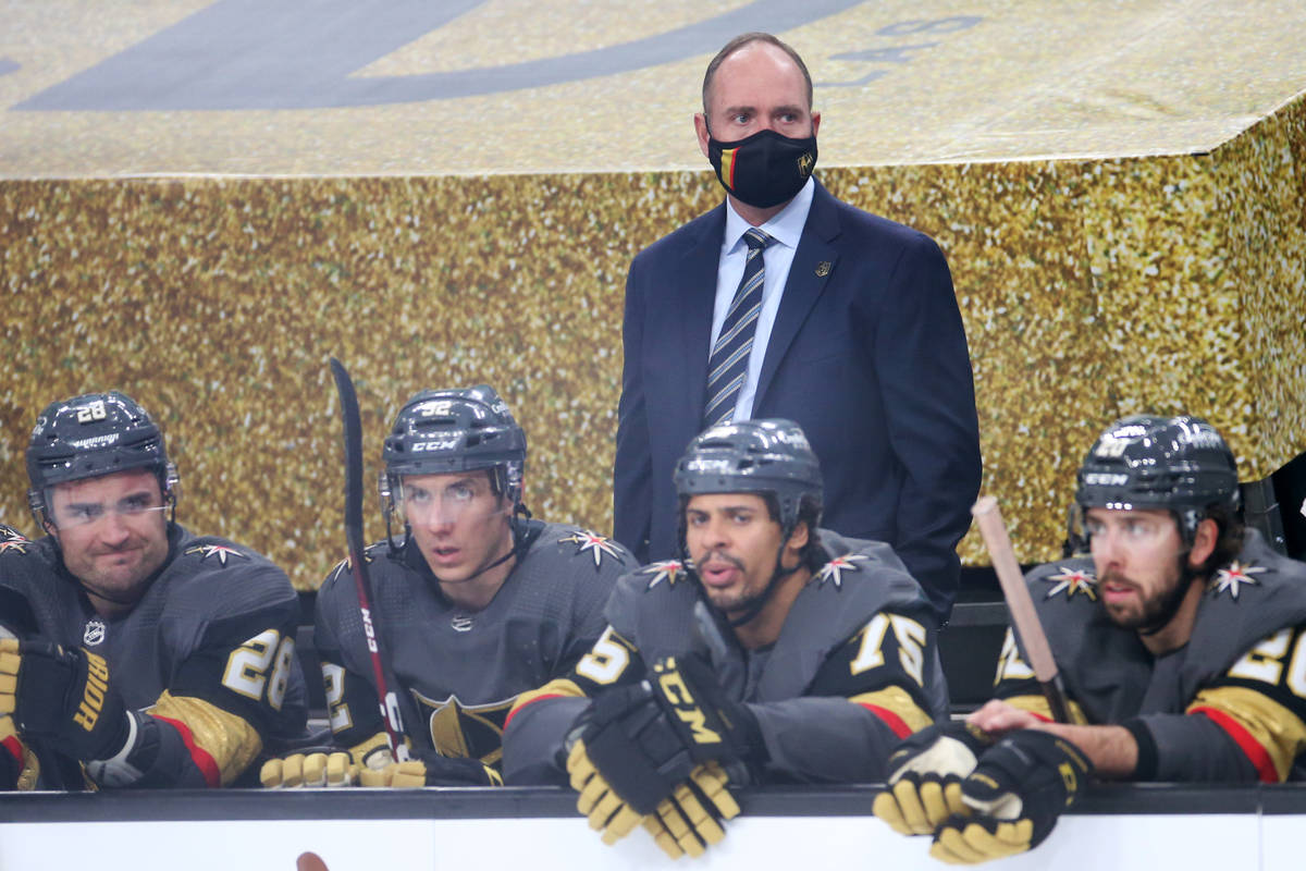 Vegas Golden Knights head coach Peter DeBoer, center, during the second period of an NHL hockey ...