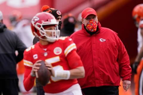 In this Sunday, Jan. 17, 2021, file photo, Kansas City Chiefs head coach Andy Reid, right, watc ...