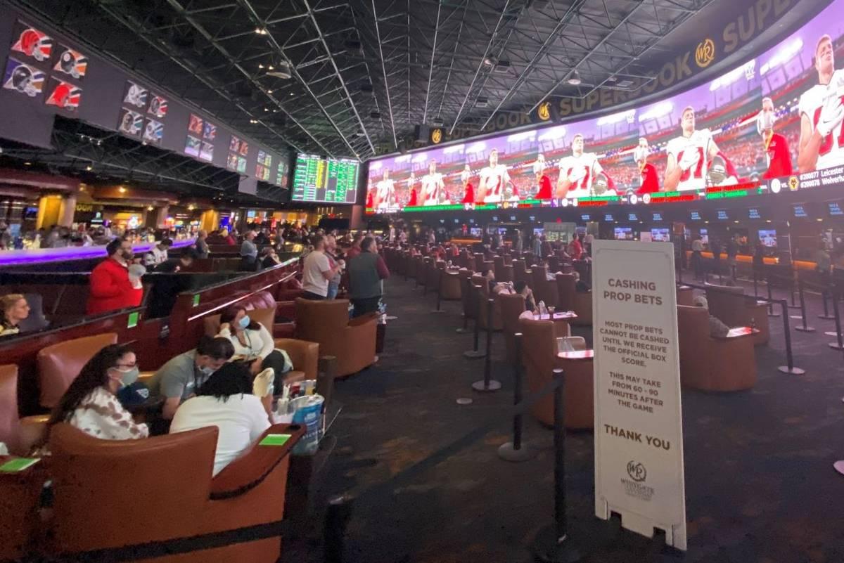 The Super Bowl LV scene at Westgate Las Vegas' SuperBook is shown on Sunday, Feb. 7, 2021. (Joh ...