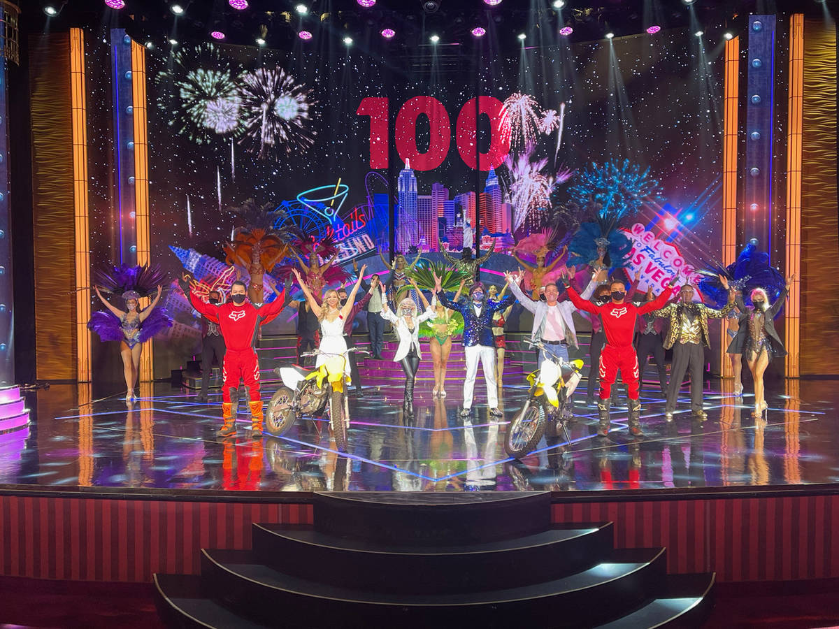 """The cast of """"Extravaganza"""" celebrates its 100th show at Bally's on Friday, Feb. 5, 2021. (Dov N ..."""